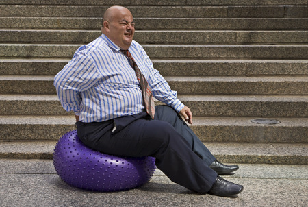 Businessman Using Exercise Ball LANG_EVOIMAGES