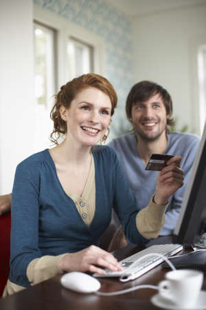 electronic commerce: Couple with Credit Card and Computer