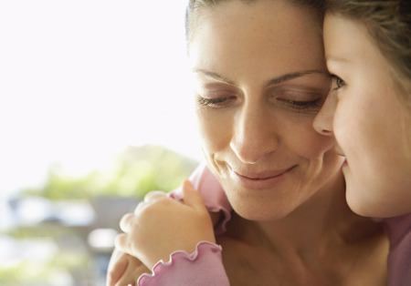 embraced: Portrait of Mother and Daughter