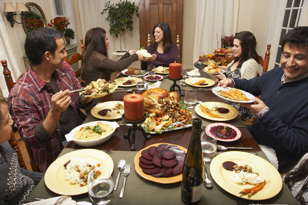 Family Having Thanksgiving Dinner LANG_EVOIMAGES