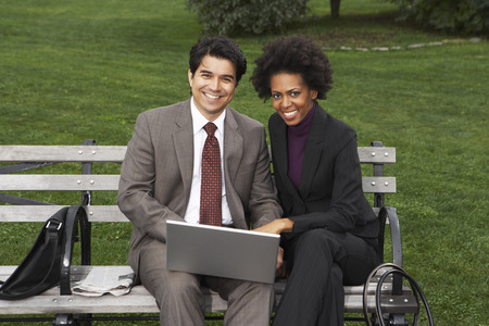 run down: Business People on Park Bench, New York City, New York, USA