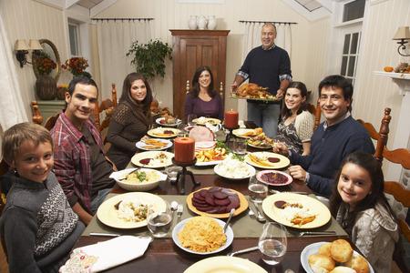 Family Having Thanksgiving Dinner LANG_EVOIMAGES