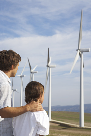 expressing: Father and Son Looking at Wind Turbines