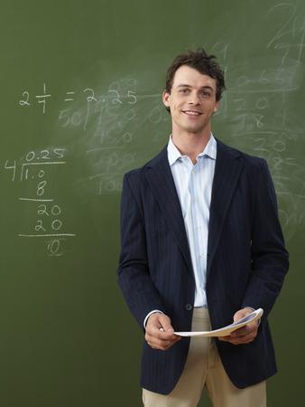 vocational high school: Teacher Standing in Front of Blackboard