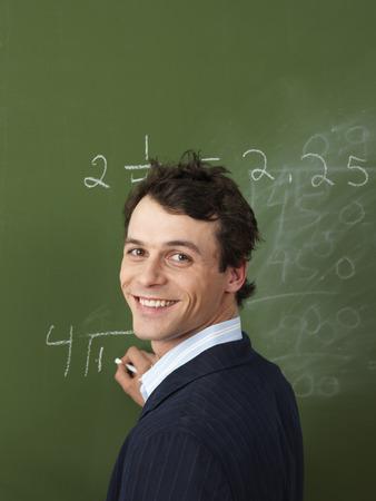 vocational high school: Teacher Writing on Blackboard