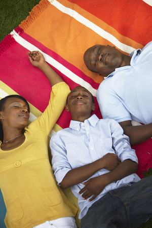 12 13: Family Asleep on Blanket LANG_EVOIMAGES