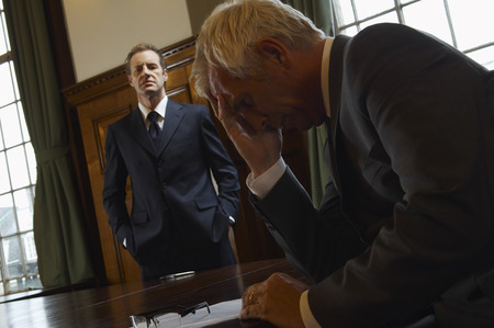 Businessmen in Large Boardroom LANG_EVOIMAGES