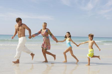 oceanic: Family Running on Beach, Malorca, Spain, Marjorca, Spain LANG_EVOIMAGES