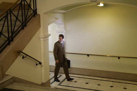 skepticism: Businessman Walking in Hallway