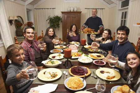 Family Toasting at Thanksgiving Dinner