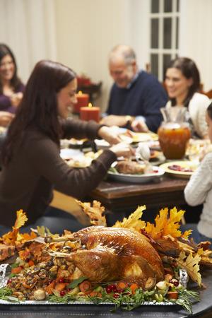 grampa: Family Having Thanksgiving Dinner LANG_EVOIMAGES