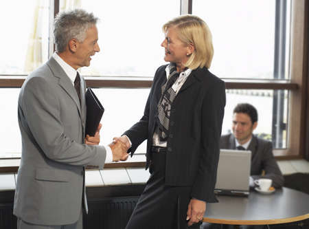 Business People Shaking Hands LANG_EVOIMAGES