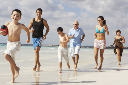 grampa: Family Playing Football on the Beach