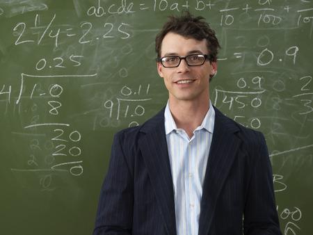 vocational high school: Teacher in Front of Blackboard LANG_EVOIMAGES