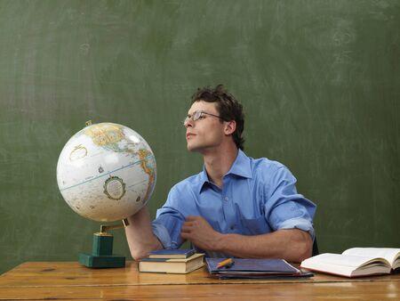 vocational high school: Teacher Looking at Globe