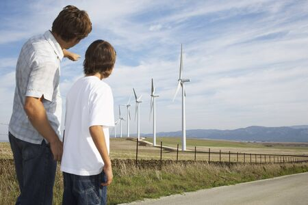 Father and Son Looking at Wind Turbines