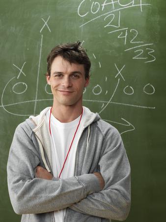 vocational high school: Coach in Front of Blackboard