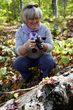 Woman Filming in Forest