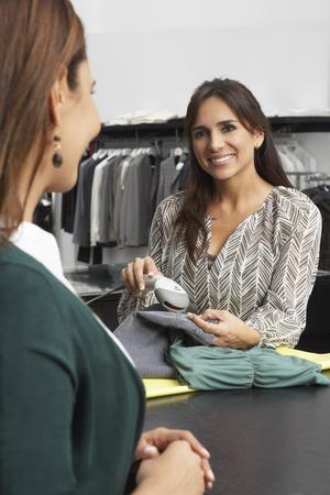 Clerk Scanning Purchases LANG_EVOIMAGES