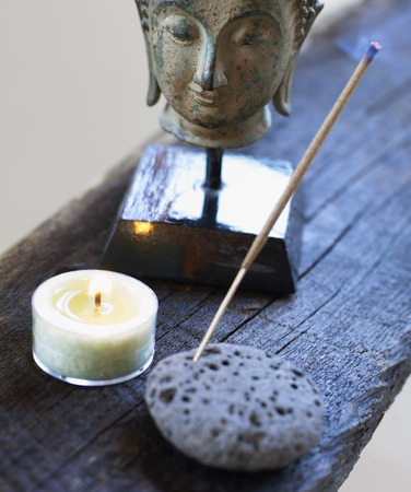Still Life of Head of Buddha, Candle, and Incense LANG_EVOIMAGES