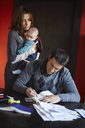 homeoffice: Couple with Paperwork and Baby