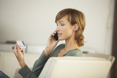 Woman with Cellular Phone and Credit Card LANG_EVOIMAGES
