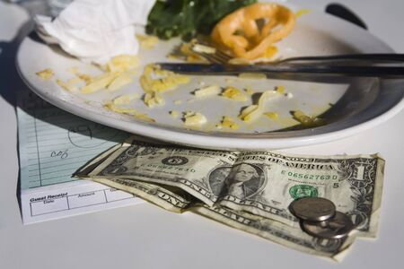 Dirty Plate with Bill and Money