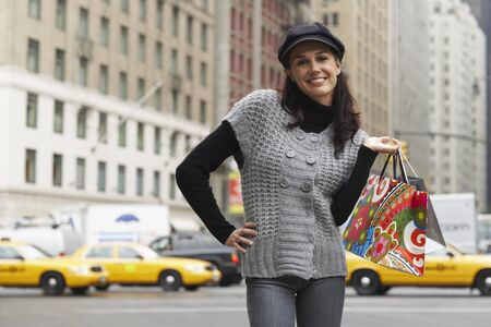 Portrait of Woman in City with Shopping Bags, New York City, New York, USA
