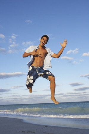 Man Jumping on the Beach LANG_EVOIMAGES