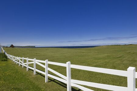 Field and White Fence, Gaspe, Quebec, Canada