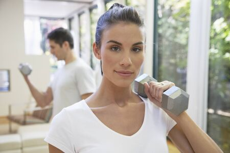 Couple Exercising in Home