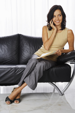 homeoffice: Woman Talking on Cell Phone