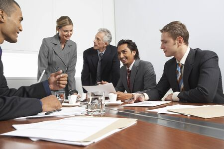 persuading: Business People at Meeting LANG_EVOIMAGES