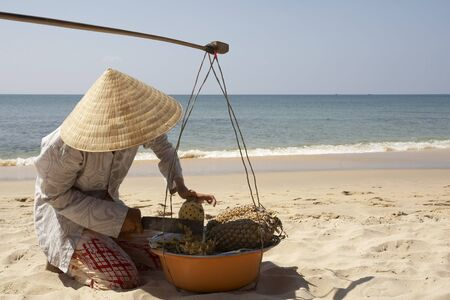 oceanic: Selling Fruit on the Beach, Phu Quoc, Vietnam LANG_EVOIMAGES