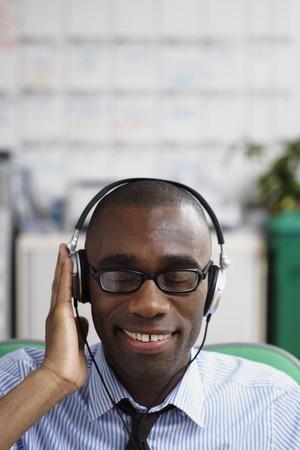Businessman Wearing Headphones LANG_EVOIMAGES