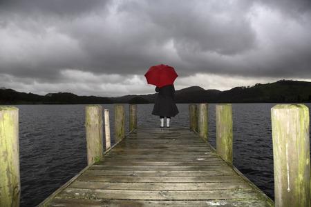 Girl on Dock in Rain, Lake Windermere, Cumbria, England