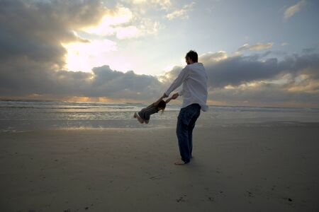 oceanic: Father and Daughter on the Beach