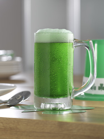 cloverleaf: Glass of Green Beer on Table
