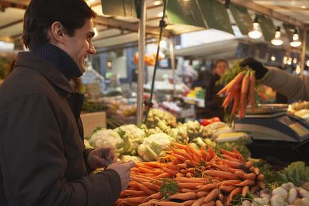 merchant: Man at the Market, Paris, France LANG_EVOIMAGES