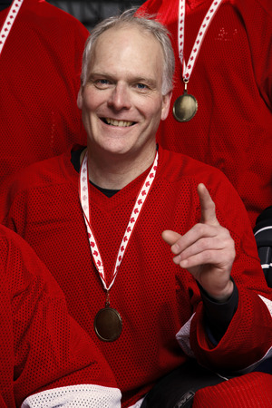 expressing: Portrait of Hockey Player Wearing Medal