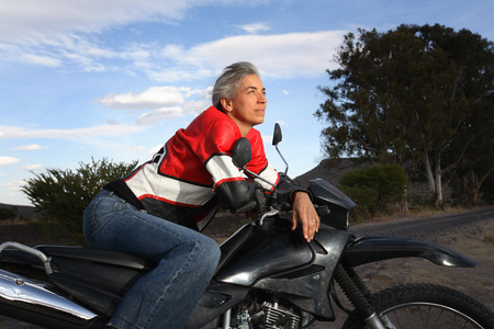 Woman Sitting on Motorcycle, Mexico LANG_EVOIMAGES