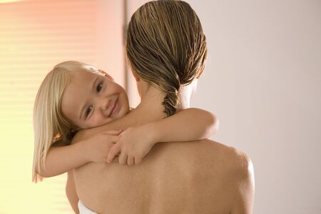 tenderly: Portrait of Little Girl in Mothers Arms