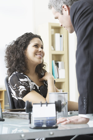 coy: Man and Woman Flirting in Office