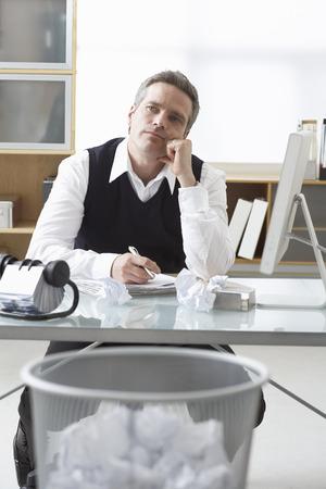 homeoffice: Businessman Sitting at Desk Writing