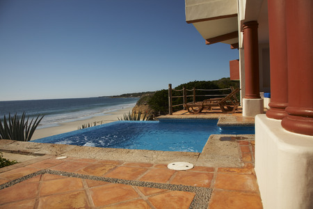 oceanic: Hotel Swimming Pool by Beach, Fairmont Rancho Banderas, Bahia de Banderas, Nayarit, Mexico LANG_EVOIMAGES