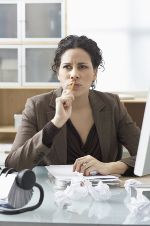 homeoffice: Businesswoman Sitting at Desk Writing LANG_EVOIMAGES