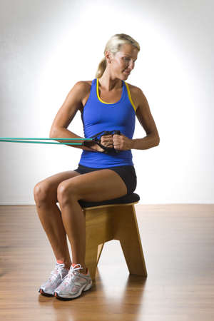 exerting: Woman Using Exercise Band