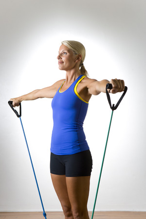 Woman Using Exercise Band