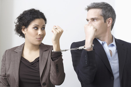 Businessman and Businesswoman Handcuffed Together