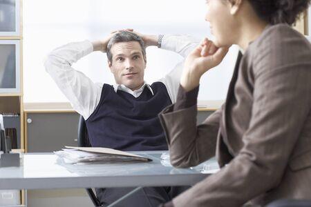 skepticism: Business People Talking at Desk